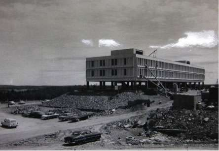 Black and white photo of Huntington University under construction. Huntington University opened in 1960.