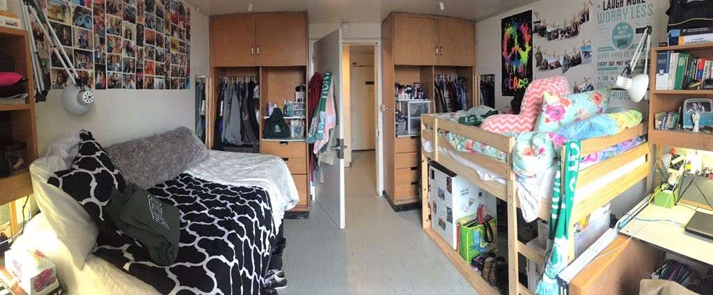 Wide shot of double residence room at Huntington University, which shows two beds, closets, doorway.